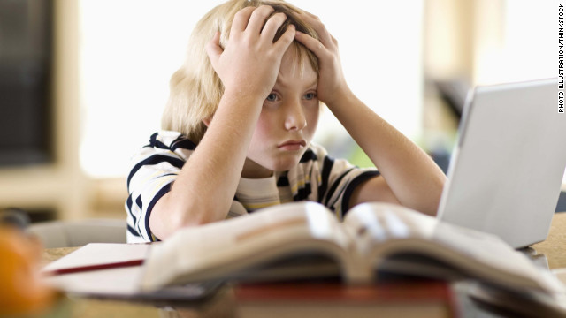 120216125149-stressed-kid-boy-laptop-frustrated-computer-story-top